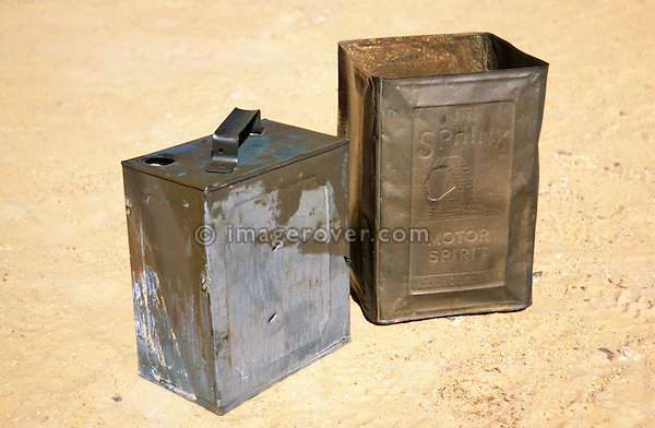 Africa, Libya, Fezzan. World War Second petrol cans at a battlefield in a valley of the Gebel Sherif mountains southwest of Kufra. During Second World War on January 31 1941 the Long Range Desert Group was attacked by the Italian Compagnie Sahariane. Libyen 1999/2000.<br /> <br />  --- No releases available. Automotive trademarks are the property of the trademark holder, authorization may be needed for some uses.<br /> <br />  --- INFO: The Long Range Desert Group (LRDG) was a reconnaissance and raiding unit of the British Army during the Second World War. Originally called the Long Range Patrol Unit (LRP), the unit was founded in Egypt in June 1940 by Major Ralph A. Bagnold. Bagnold was assisted by Captain Patrick Clayton and Captain William Shaw. At first the majority of the men were from New Zealand, but they were soon joined by Rhodesian and British volunteers, whereupon new sub-units were formed and the name was changed to the better-known Long Range Desert Group (LRDG).<br /> <br /> The LRDG vehicles were mainly two wheel drive, chosen because they were lighter and used less fuel than four wheel drive. They were stripped of all non-essentials, including doors, windscreens and roofs. They were fitted with a bigger radiator, a condenser system, built up leaf springs for the harsh terrain, wide, low pressure desert tyres, sand mats and channels etc. Initially the LRDG patrols were equipped with one CMP Ford 15 cwt F15 truck for the commander, while the rest of the patrol used up to 10 Chevrolet 30 cwt WB trucks.<br /> <br /> On 31 January 1941 'T' Patrol commanded by Captain Patrick Clayton was attacked by the Compagnia Autosahariana di Cufra, an Italian unit similar to the LRDG, in the Gebel Sherif valley south of Cufra, Libya. The LRDG had one man killed and three men captured, and three of the eleven trucks were destroyed during the battle. The Italians losses were five killed and three wounded, and one truck was abandoned.