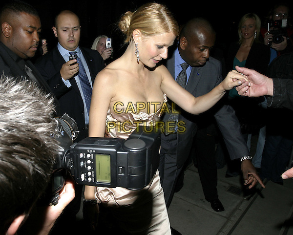GWYNETH PALTROW.Sky Captain & The World OF Tomorrow Premiere.UCI Empire, Leicester Square.Monday, September 27th, 2004.half length, strapless, cameras, paparazzi, photographers, holding hands, cleavage.www.capitalpictures.com.sales@capitalpictures.com.© Capital Pictures.