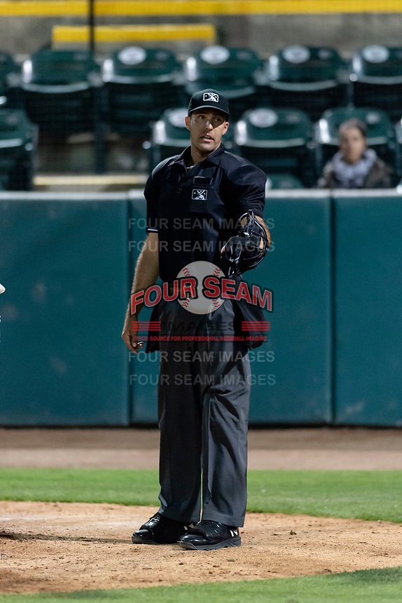 Home plate umpire Ty Kraus talks to Visalia Rawhide manager Shawn Roof (not pictured) during a California League game against the Rancho Cucamonga Quakes at Rawhide Ballpark on April 8, 2019 in Visalia, California. Rancho Cucamonga defeated Visalia 4-1. (Zachary Lucy/Four Seam Images)