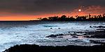 reflective sunset over waves in Kona, Hawaii