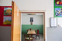 Serbia. Veliki Trnovac (in Albanian: Tërnoc i Madh) is a town in the municipality of Bujanovac, located in the Pčinja District of southern Serbia. « Muharrem Kadriu » Elementary School. Teachers' meeting room. Tables and chairs. Drawings on the walls. Bujanovac is located in the geographical area known as Preševo Valley. The Pestalozzi Children's Foundation (Stiftung Kinderdorf Pestalozzi) is advocating access to high quality education for underprivileged children. It supports in Bujanovac a project called » Our towns, our schools ». 16.4.2018 © 2018 Didier Ruef for the Pestalozzi Children's Foundation