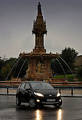 the first new style Ford Fiesta in the country gets a run around a wet Glasgow, here at the Doulton Fountain in Glasgow Green - - picture by Donald MacLeod 16.09.08