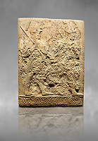 Hittite sculpted orthostats panels of Long Wall Limestone, Karkamıs, (Kargamıs), Carchemish (Karkemish), 900-700 B.C. Soldiers. Anatolian Civilisations Museum, Ankara, Turkey<br /> <br /> Figure of two helmeted warriors. They have their shield in their back and their spear in their hand. The prisoner in their front is depicted as small. The lower part of the orthostat is decorated with braiding motifs. <br /> <br /> On a grey art background.