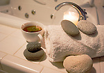 Spa setting with tea candle towel rocks