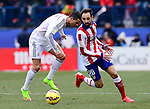Real Madrid's Portuguese forward Cristiano Ronaldo and Atletico Madrid's midfielder Juanfran during the Spanish league football match Club Atletico de Madrid vs Real Madrid CF at the Vicente Calderon stadium in Madrid on February 7, 2015.          PHOTOCALL3000/ DP