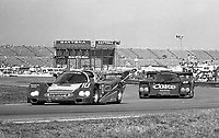 The #1 Porsche 962 of A.J. Foyt, Al Unser and Danny Sullivan leads the  #5 Porsche 962 of Hans Joachim Stuck, James Weaver and Bob Akin during the Rolex 24 at Daytona, Daytona International Speedway, Daytona Beach, FL, February 1, 1987.  (Photo by Brian Cleary/www.bcpix.com)