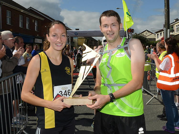 Chairperson of Duleek AC presents Fiona O'Rourke from Dunshaughlin AC with the trophy for first lady home in the Duleek 10K run. Photo:Colin Bell/pressphotos.ie