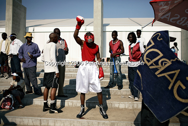 SOWETO, SOUTH AFRICA SEPTEMBER 23: A boxer prepares to go inside the ring for a match on September 23, 2006 in Soweto, Johannesburg, South Africa. The tournament was part of Soweto festival. Soweto is South Africa&rsquo;s largest township and it was founded about one hundred years to make housing available for black people south west of downtown Johannesburg. The estimated population is between 2-3 million. Many key events during the Apartheid struggle unfolded here, and the most known is the student uprisings in June 1976, where thousands of students took to the streets to protest after being forced to study the Afrikaans language at school. Soweto today is a mix of old housing and newly constructed townhouses. A new hungry black middle-class is growing steadily. Many residents work in Johannesburg but the last years many shopping malls have been built, and people are starting to spend their money in Soweto.  <br /> (Photo by Per-Anders Pettersson)