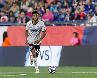 FOXBOROUGH, MA - JUNE 27: Auston Trusty #26 brings the ball forward during a game between Philadelphia Union and New England Revolution at Gillette Stadium on June 27, 2019 in Foxborough, Massachusetts.