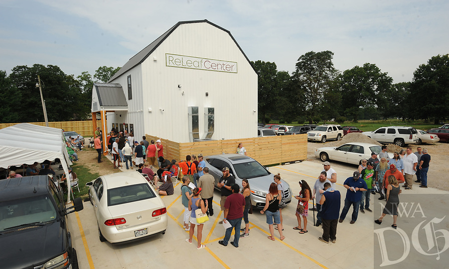 NWA Democrat-Gazette/ANDY SHUPE<br /> A long line forms Wednesday, Aug. 7, 2019, during the first day of operations for The ReLeaf Center, a medical marijuana dispensary located at 9400 E. McNelly Rd. in Bentonville, the first of its kind in Northwest Arkansas.