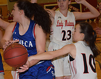 RICK PECK/SPECIAL TO MCDONALD COUNTY PRESS<br /> McDonald County's Lily Allman knocks the ball loose from Seneca's Haley Miller during the Lady Mustangs 44-31 loss on Jan. 11 at MCHS.