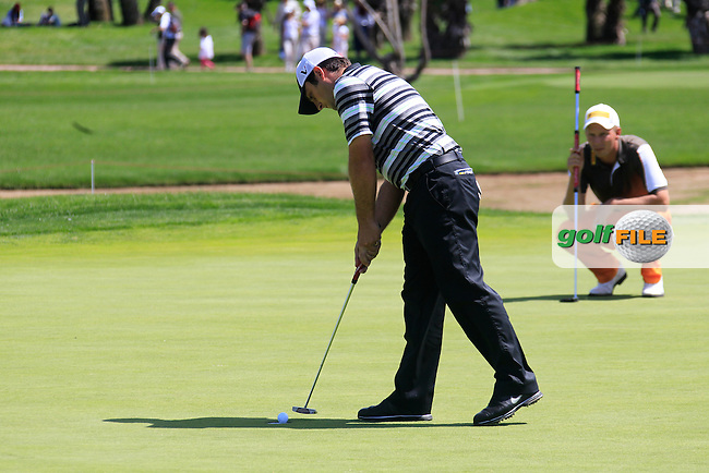 Francesco Molinari (ITA) takes his putt on the 15th green during Sunday's Final Round of the Open de Espana at Real Club de Golf de Sevilla, Seville, Spain, 6th May 2012 (Photo Eoin Clarke/www.golffile.ie)
