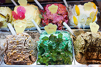 Gelato ice cream shop selling mint, hazlenut, coffee, lemon, strawberry flavours in Siena, Italy.