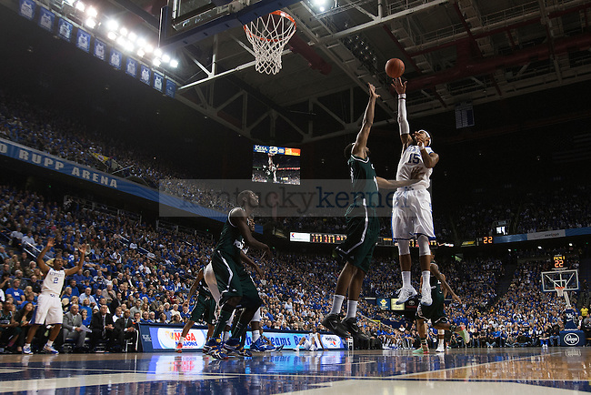 UK forward Willie Cauley-Stein shoots over the Eastern Michigan defender during the first half of the University of Kentucky men's basketball game vs. Eastern Michigan at Rupp Arena in Lexington, Ky., on Wednesday, November 27, 2013. Kentucky leads Eastern Michigan 35-32.Photo by Michael Reaves | Staff