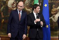 Roma, 22 Febbraio 2014.<br /> Palazzo Chigi.<br /> Primo giorno del Governo con Matteo Renzi Premier.<br /> Nella foto: La cerimonia della Campanella dove il Premier uscente Enrico Letta passa la consegna al nuovo Primo Ministro Matteo Renzi.