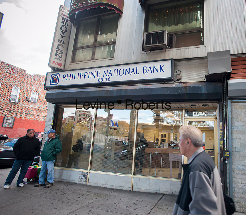 "A branch of the Philippine National Bank on Roosevelt Avenue in Queens in New York in the ""Little Manila"" neighborhood on Friday, November 8, 2013. Super Typhoon Haiyan, which meteorologists think might be the strongest storm ever recorded, has hit the Philippines with fatalities and massive property destruction. The storm has sustained winds of 195 mph (315 kph) and approximately 125,000 people evacuated.  Fifteen percent, about 13,000 people, are of Filipino background and live in Woodside. (© Richard B. Levine)"