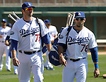 Dodgers Scott Van Slyke, left, and Alex Casetllanos head to the dugout for a Cactus League preseason game between the Giants and the Dodgers in Glendale, Ariz., on Tuesday, March 6, 2012.  .Photo by Cathleen Allison