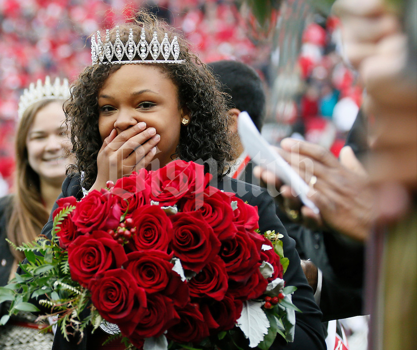 Chasmine Anderson reacts as she is named the 2014 Homecoming Queen before Saturday's NCAA Division I football game between the Ohio State Buckeyes and the Rutgers Scarlet Knights at Ohio Stadium in Columbus on Saturday, Oct. 18, 2014. (Dispatch Photo by Barbara J. Perenic)