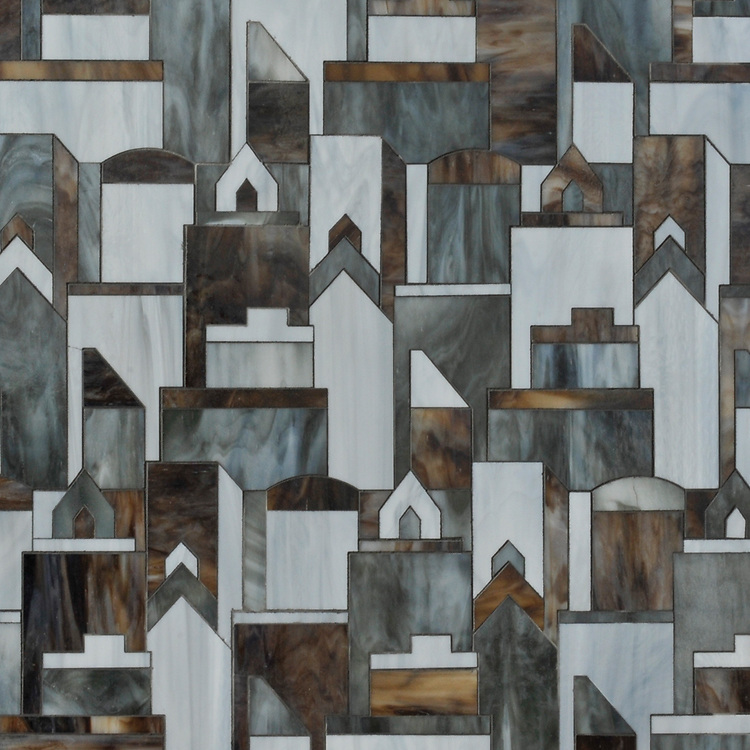 Cityscape, a waterjet jewel glass mosaic shown in Pearl, Lavastone, and Tourmaline, is part of the Erin Adams Collection for New Ravenna Mosaics.