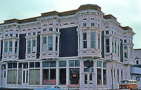 Ferndale CA: Victorian Village Inn (formerly Bank & Office Building), c. 1880's. SE Corner Main St. & Ocean Ave.  Photo '83.