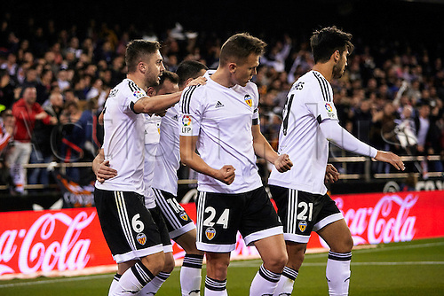 06.03.2016. Mestalla Stadium, Valencia, Spain. La Liga match between Valencia versus Atletico Madrid. Midfielder Denis Cheryshev of Valencia CF (C) celebrates with his team mates after scoring the first goal for his team