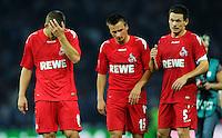 1. Oktober 2011: Berlin, Olympiastadion: Fussball 1. Bundesliga, 8. Spieltag: Hertha BSC - 1. FC Koeln: Koelns Lukas Podolski, Slawomir Peszko und Sascha Riether (v.l.n.r.) sind nach dem Spiel enttaeuscht.
