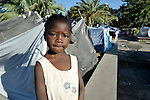 A girl stands among the makeshift shelters of a camp for people left homeless by the January 12 earthquake in Port-au-Prince, Haiti.