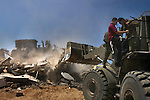 Standing on a bulldozer, an Israeli soldier scuffles with a protesting Israeli settler, where houses are being demolished, in the Israeli settlement bloc of Gush Katif, Gaza Strip.<br /> Israeli army demolished a row of old Egyptian houses, to prevent their renovation by hardline Israeli settlers who recently moved-in to Gush Katif in order to resist Israel's upcoming pullout from Gaza.
