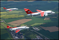 BNPS.co.uk (01202 558833)<br /> Pic: CrownCopyright/AirHistoricalBranch<br /> <br /> Queens Flight BAe146 and 2 HS 125's in 2002.<br /> <br /> A new book gives an intimate look behind the scenes of the Royal Flight and also the flying Royals.<br /> <br /> Starting in 1917 the book charts in pictures the 100 year evolution of first the King's Flight and then later the Queen's Flight as well as the Royal families passion for aviation.<br /> <br /> Author Keith Wilson has had unprecedented access to the Queen's Flight Archives to provide a fascinating insight into both Royal and aeronautical history.