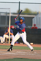 Chad Smith (7) of the AZL Rangers warms bats during a game against the AZL Angels at the Texas Rangers Spring Training Complex on July 1, 2015 in Surprise, Arizona. Rangers defeated Angels, 3-1. (Larry Goren/Four Seam Images)