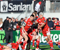 Hendon, England. Duncan Williams of Munster clears the ball during the European Rugby Champions Cup match between Saracens and Munster at Allianz Park stadium on January 17, 2015 in Hendon, England.