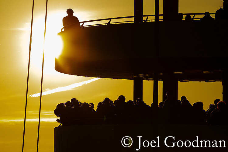 © Joel Goodman - 07973 332324. Manchester, UK  30/04/2012. Fans crowd look out at the sunset at SportCity at the City of Manchester Stadium on the Etihad Campus , home of Manchester City Football Club , ahead of a local derby match between Manchester City and Manchester United . Photo credit: Joel Goodman