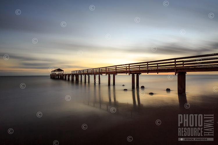 A long exposure image taken after the sun has set at Waimea Pier fills the sky with peace and the ocean with calm, Waimea, Kaua'i.