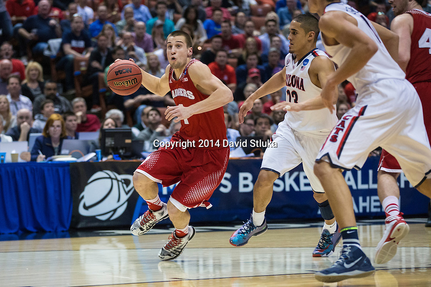 Wisconsin Badgers guard Ben Brust (1) handles the ball during  a regional final NCAA college basketball tournament game against the Arizona Wildcats Saturday, March 29, 2014 in Anaheim, California. The Badgers won 64-63 (OT). (Photo by David Stluka)