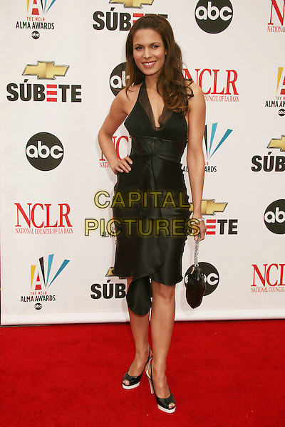 NADINE VELAZQUEZ.2007 NCLR ALMA Awards at the Pasadena Civic Center,.Pasadena, California, USA,.1st June 2007..full length black halterneck dress hand on hip.CAP/ADM/BP.©Byron Purvis/AdMedia/Capital Pictures.