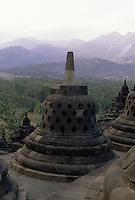 Central Java, Indonesia: detail of The Borobudur temple,  stupas.<br /> Indonesia, Giava: dettagli del tempio Borobudur, le  stupe.