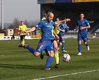 David Raven clears under pressure from John McGinn in the Inverness Caledonian Thistle v St Mirren Scottish Professional Football League Premiership match played at the Tulloch Caledonian Stadium, Inverness on 29.3.14.