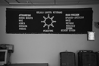 A banner commemorating Lakota participation in American wars on the wall at the Shelter for homeless veterans in Pine Ridge Indian Reservation.