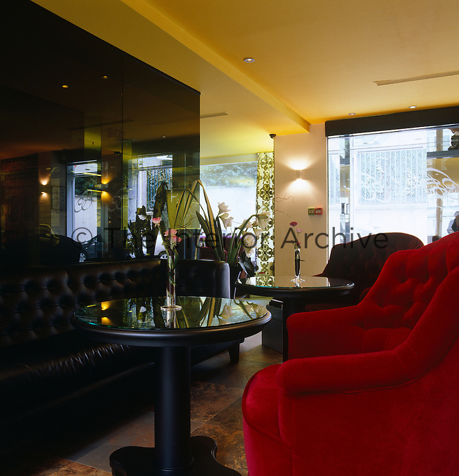 Leather banquettes and armchairs covered in richly coloured velvet are scattered around the lobby of the hotel