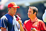 4 July 2010: Washington Nationals Manager Jim Riggleman is interviewed by radio broadcaster Charlie Slowes prior to a game against the New York Mets at Nationals Park in Washington, DC. The Mets defeated the Nationals 9-5 in the fourth game and splitting their 4-game series. Mandatory Credit: Ed Wolfstein Photo