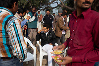 Minister of Legislative Assembly, Ritesh Pandey, 30, accepts refreshments from villagers after inaugurating a cricket tournament for 20-25 year olds in Saharanpur Umran, Ambedkar Nagar, Uttar Pradesh, India, on 21st January, 2012. Returning 1.5 years ago after almost 10 years abroad, Pandey is contesting on behalf of the Bahujan Samaj Party (BSP), a party that is based on its appeal to Dalit (the lowest Hindu caste) voters. Party leader Mayawati, herself a Dalit, has recently been giving out more tickets to muslims and high caste candidates in an attempt to woo a larger spectrum of voters in Uttar Pradesh, a Bellwether state. Photo by Suzanne Lee for The National (online byline: Photo by Szu for The National)