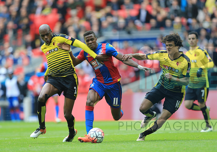 Crystal Palace's Wilfred Zaha tussles with Watford's Allan Nyom and Nathan Ake during the Emirates FA Cup, Semi-Final match at Wembley Stadium, London.  Photo credit should read: David Klein/Sportimage