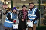 Pauline Darby gives a donation to Christine Ferris and Gerry Fitzgerald who were collecting  for Drogheda Homeless Aid at the annual Christmas 24hr sleepout. Photo:Colin Bell/pressphotos.ie