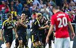 Solna 2013-08-06 Football Friendly Game , AIK - Manchester United FC :  <br /> AIK 15 Robin Quaison gratuleras av AIK 9 Martin Kayongo Mutumba och AIK 2 Niklas Backman efter sitt 1-0 m&aring;l<br /> (Foto: Kenta J&ouml;nsson) Nyckelord:  jubel gl&auml;dje lycka glad happy