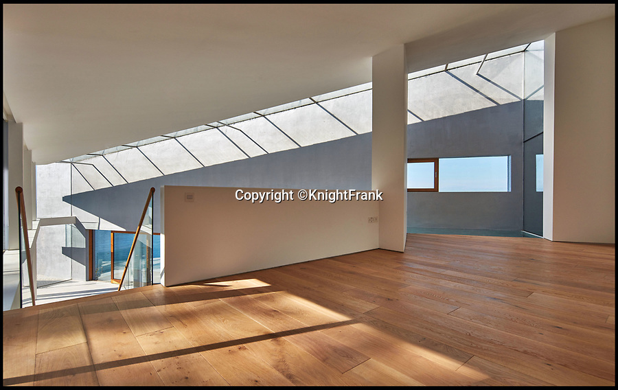 BNPS.co.uk (01202 558833)<br /> Pic: KnightFrank/BNPS<br /> <br /> Stealth House - Stunning new clifftop villa...above genteel Ilfracombe.<br /> <br /> A super-stylish new cliff-top property that would not look out of place in a James Bond film has gone on the market for £2.5m.<br /> <br /> The aptly-named Stealth House has been cleverly designed to blend into its hillside background from across the bay, but the striking home also has lots of glass to take advantage of the breathtaking uninterrupted sea views.<br /> <br /> The five-bedroom property, on a hill above Combe Martin Bay in north Devon, replaced a tired bungalow and the build was only completed this summer, so the buyers would be the first people to live in the swanky home.<br /> <br /> It is now on the market with Knight Frank and also has an infinity pool.