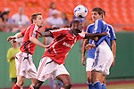 July 1 2007:  Maurice Edu (center) of Toronto FC beats teammate Andy Welsh (l) and Wizards player Carlos Marinelli (10) to a loose ball.  The MLS Kansas City Wizards tied the visiting Toronto FC 1-1 at Arrowhead Stadium in Kansas City, Missouri, in a regular season league soccer match.