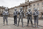 London, UK. 27 April 2014. Cybermen in the Courtyard of Somerset House. Sci-Fi fans gathered in the Courtyard of Somerset House, London, and dressed up as their favourite science fiction character ahead of a parade through London. This 4th annual parade was organised by Sci-Fi London 14, the London International Festival for Science Fiction and Fantastic Film which runs unil May 4th.