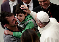 Pope Francis blesses a child at the end of  his weekly general audience in Paul VI hall at the Vatican on November 30, 2016. UPDATE IMAGES PRESS/Isabella Bonotto<br /> <br /> STRICTLY ONLY FOR EDITORIAL USE