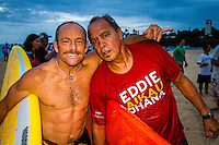 "HONOLULU, Oahu, Waimea Bay - Thursday, November 28, 2012 Tom Carroll (AUS) with Clyde Aikau (HAW). -- The 28th annual Quiksilver In Memory of Eddie Aikau official opening ceremony and blessing today at Waimea Bay on the North Shore of Oahu. The ceremony  featured this year's 28 Invitees, including newly elected riders John John Florence (Hawaii), Ian Walsh (Maui), and Alex Gray (California), as well as former ""Eddie"" champions Kelly Slater (Florida), Greg Long (California), and Ross Clarke-Jones (Australia). The surfers will be joined by members of the Aikau family, including Eddie's younger brother and Invitee Clyde Aikau...When the Invitees and Alternates paddled out and grouped in the traditional surfer's circle it's about camaraderie and making a connection to the others who will ultimately share in your experience and watch out for your safety..The holding period for the Quiksilver In Memory of Eddie Aikau will commence on Saturday, December 1, and runs through  to February 28, 2013. The event requires one day of quality waves in the giant range of 20 feet or more. Waves of this size are only generated occasionally by hurricane force winds from intense storms in the Pacific NW. The elements of wind, swell height and arrival time to the island's shore must be in perfect alignment to allow a full eight hours of daytime competition..Waimea Bay was Eddie Aikau's home away from home. It was here that he saved countless lives as the Bay's first official lifeguard, and successfully rode the largest waves of his day. An early pioneer of big wave riding in Hawaii, Eddie has inspired generations of ""storm surfers"" who today roam the globe year-round in search of giant waves..The Quiksilver In Memory of Eddie Aikau has only been held a total of eight (8) times, most recently on December 8, 2009. California's Greg Long (California) took the honor that year. .Photo: joliphotos.com"