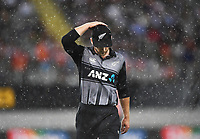 Kane Williamson leaves the field for rain.<br /> New Zealand Black Caps v Australia.Tri-Series International Twenty20 cricket final. Eden Park, Auckland, New Zealand. Wednesday 21 February 2018. &copy; Copyright Photo: Andrew Cornaga / www.Photosport.nz
